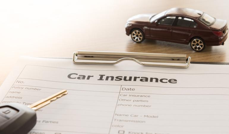 car insurance claim form with car key